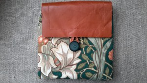 Leather flap purse made from William Morris design fabric