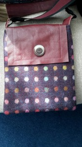 Leather flap bag, made from British Abraham Moon tweed fabric, with vintage French button detail